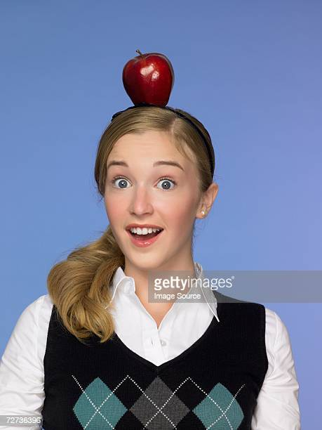 Girl balancing an apple on her head