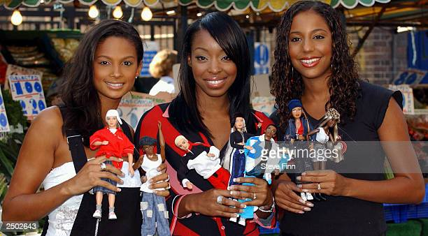 Girl band 'Misteeq' take part in a photocall to promote Flava fashion dolls on September 17 2003 in London