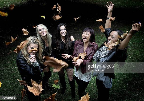 Girl band The Beach Girl5 Laura New Brooke Adams Mandy Jiroux Noreen Juliano and Dominique Domingo throw up leaves as they walk in Battersea Park on...
