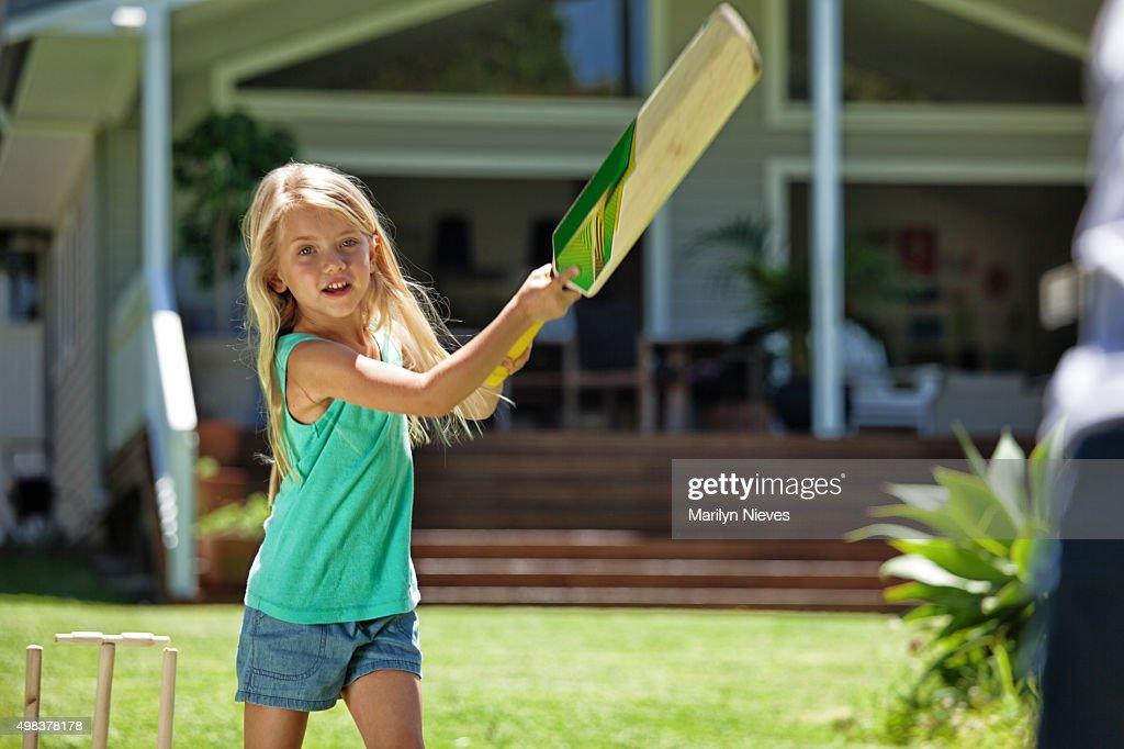 girl batting at cricket : Stock Photo