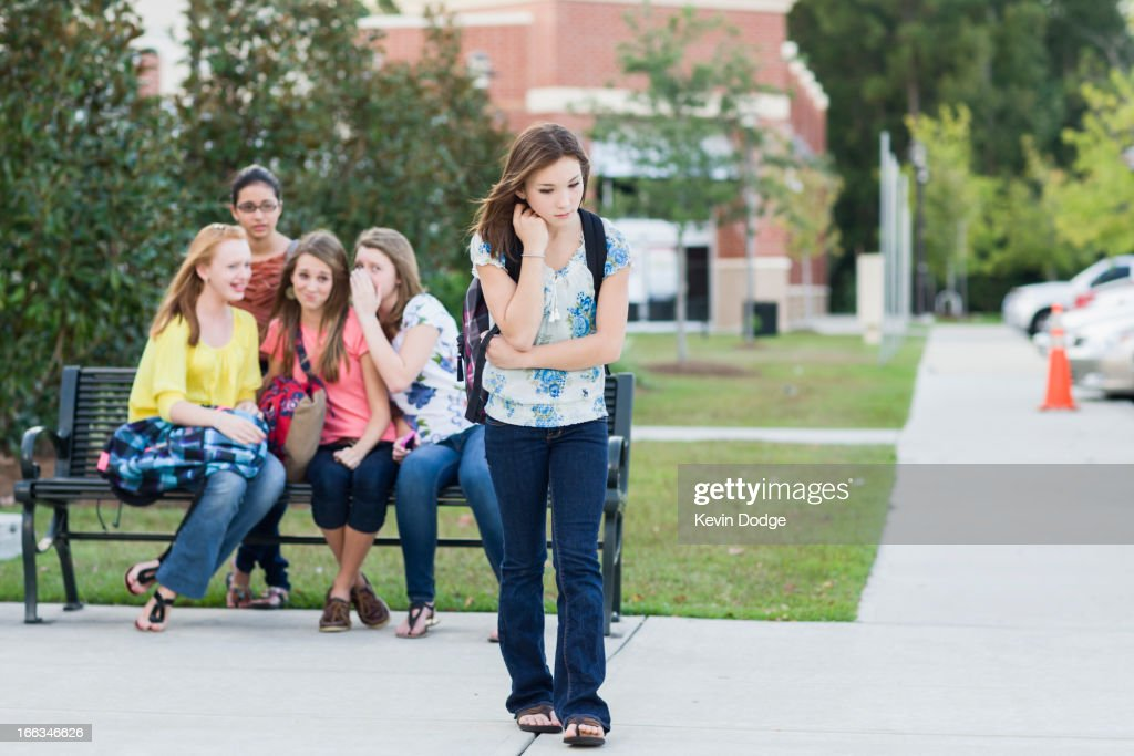 Girl being teased by other girls : Stock Photo