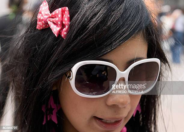 A girl belonging to the emo urban tribe at Glorieta de los Insurgentes in Mexico City on March 26 2008 After the emos a group of youngsters between...