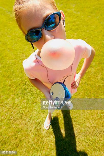 girl blowing a bubble - personal compact disc player stock pictures, royalty-free photos & images