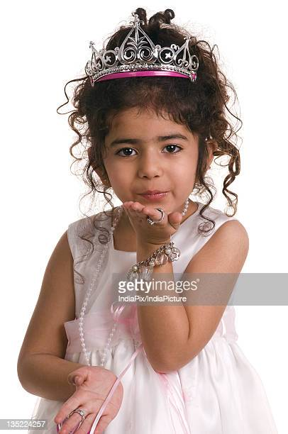 a girl blowing a kiss - indian girl kissing stock photos and pictures