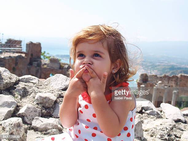 girl blowing a kiss - naxos sicily stock pictures, royalty-free photos & images