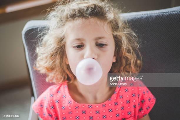 Girl Blowing Bubble Gum Bubbles