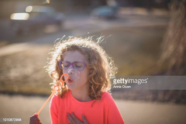 Girl blowing bubble