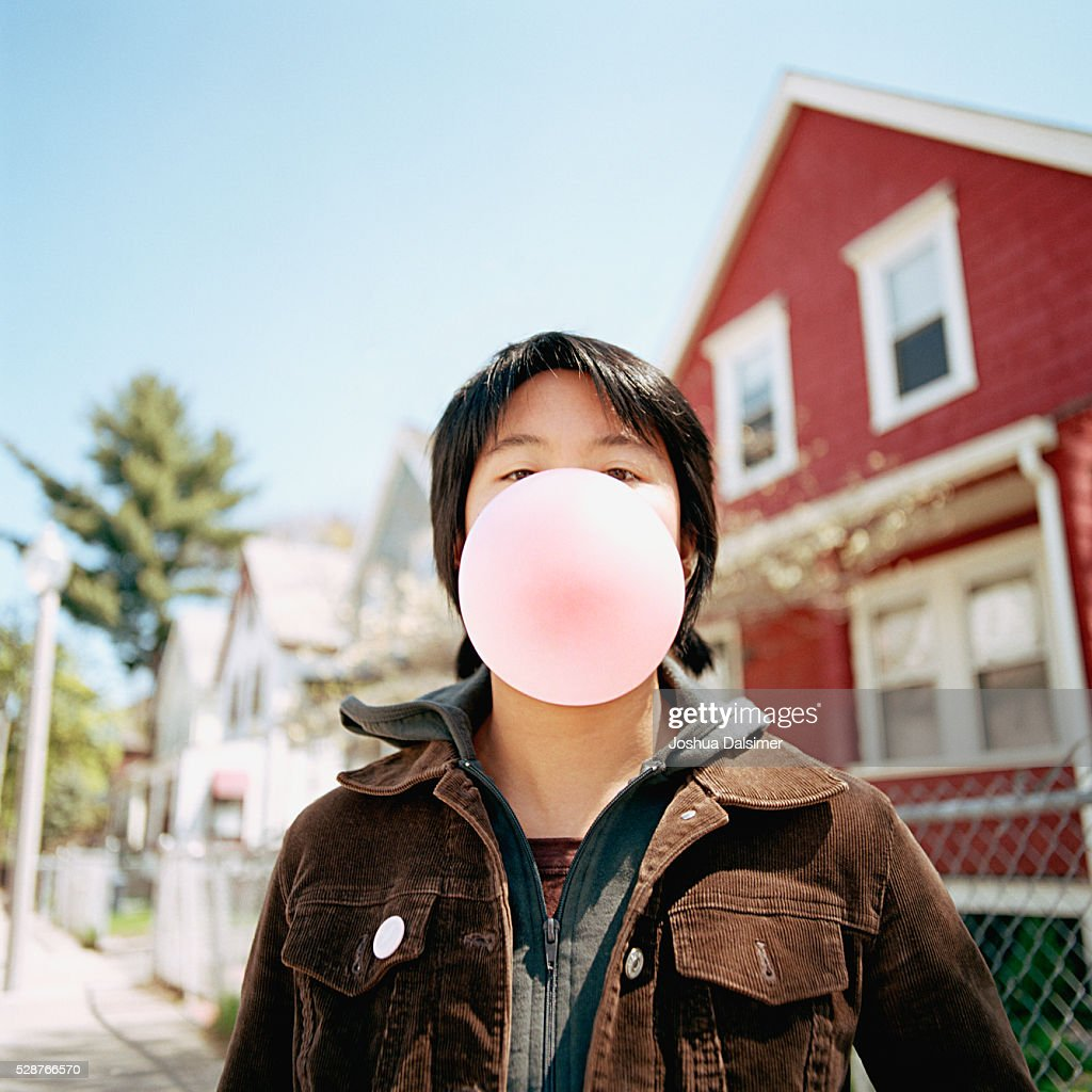 Girl blowing bubble : Stock Photo