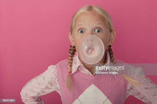 Girl blowing bubble with gum
