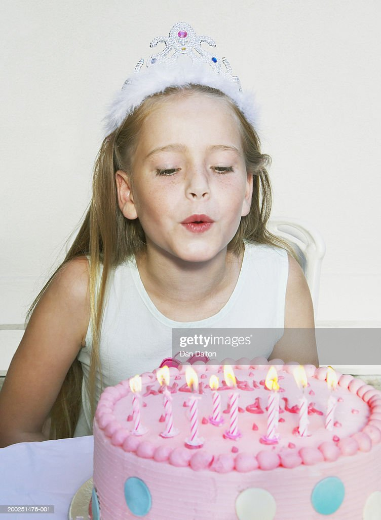Girl Blowing Out Candles On Birthday Cake Closeup Stock Photo