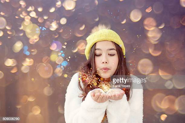 girl blowing out some glitter
