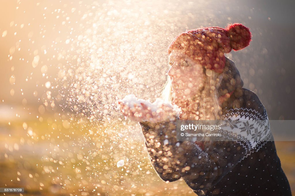 Girl Blowing Snow. Sunset. Winter Mood. : Stock Photo