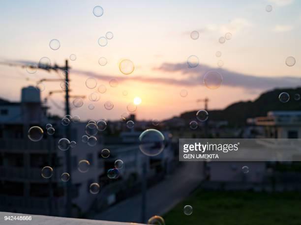 a girl blowing soap bubbles - 到着 ストックフォトと画像