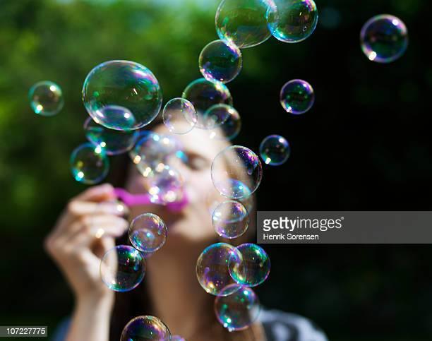 girl blowing soapbubbles