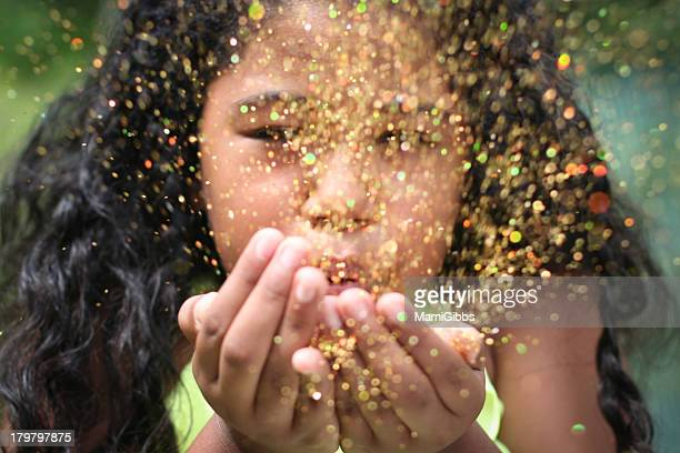Girl  blowing up glitter
