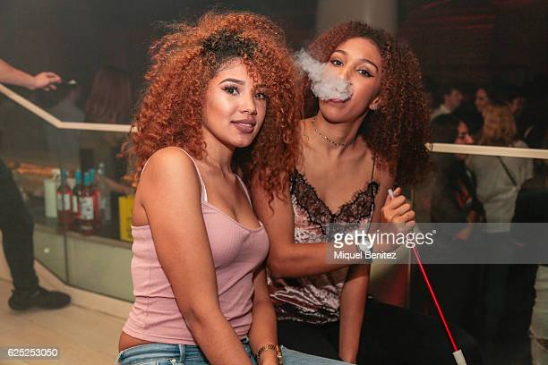 Girl blows smoke of shisha from a hookah pipe during the 'Purpose Tour' Party, Justin Bieber's after concert at Pacha Barcelona on November 22, 2016...