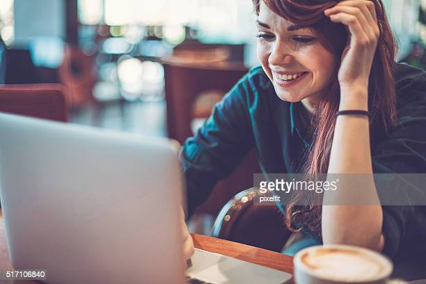 Girl browsing the net in coffee shop