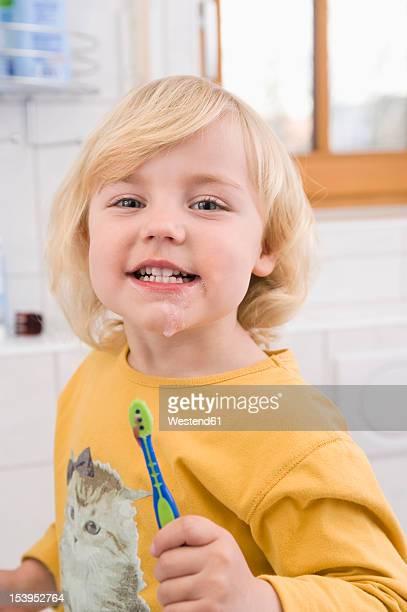 Girl brushing her teeth in bathroom, close up