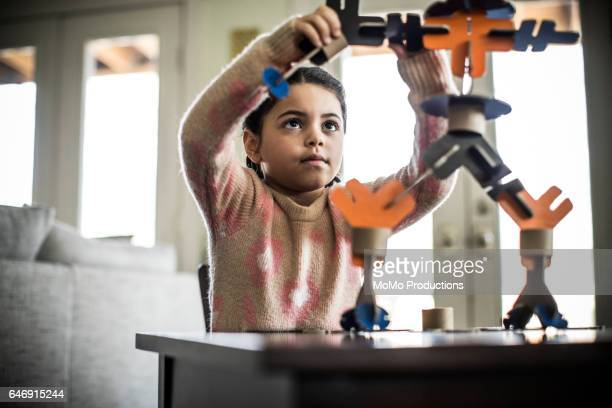 Girl building robot (7 yrs)