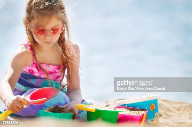 girl building sand castle - kelowna stock pictures, royalty-free photos & images