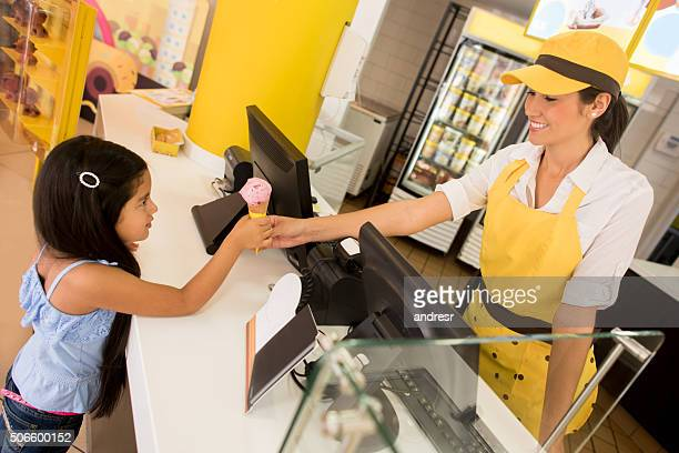 Girl buying an ice cream at a shop