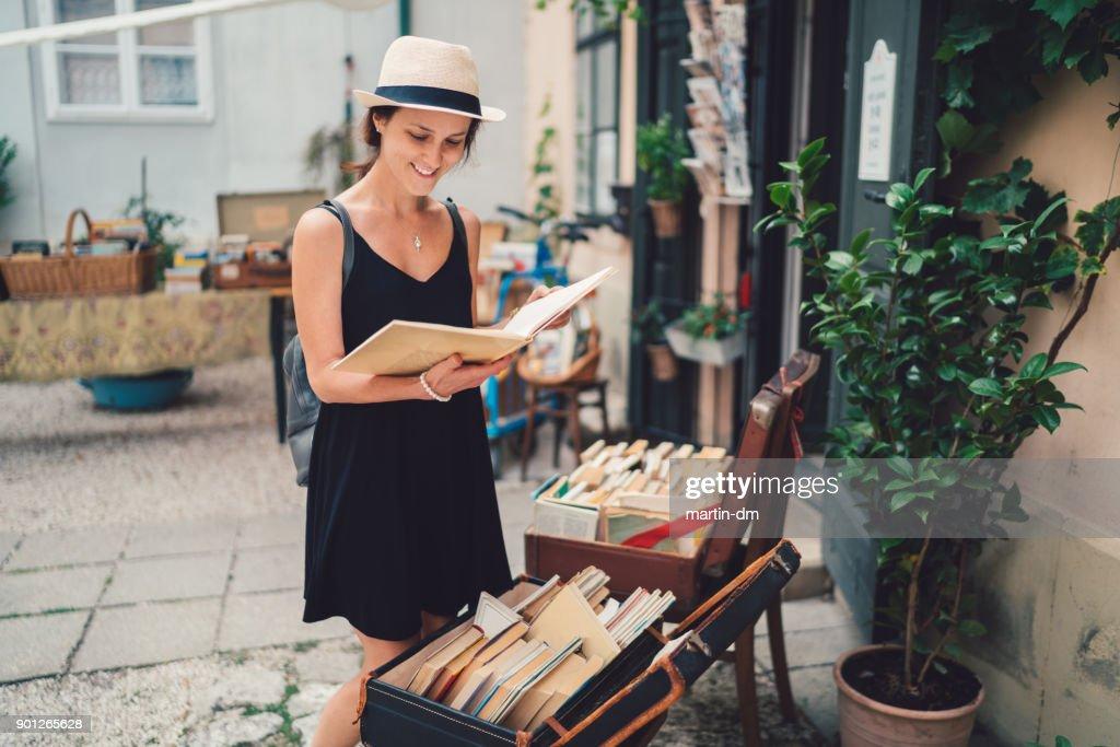 Girl buying books in Budapest : Stock Photo