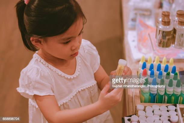 Girl buying glittering papers