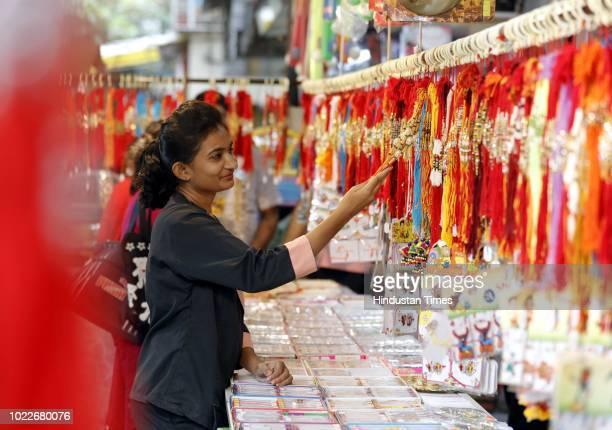 A girl buying Rakhi for Rakshabandhan at Karve Nagar on August 23 2018 in Pune India