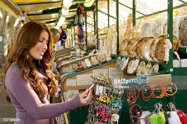 girl buying souvenirs in italy - souvenir stock pictures, royalty-free photos & images