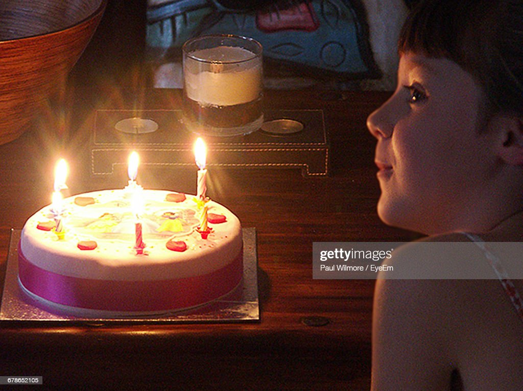 Girl By Birthday Cake On Table At Home Stock Photo Getty Images