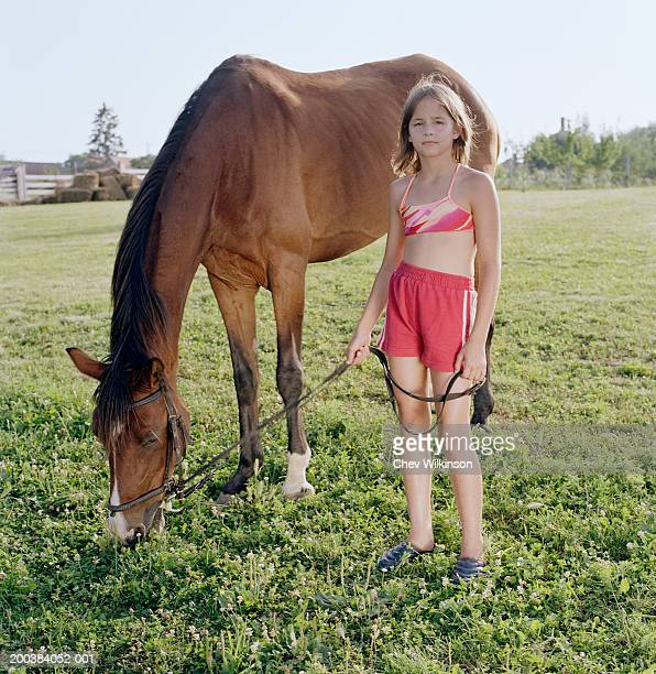 girl (10-12) by horse, holding halter, portrait - 10 11 years stock photos and pictures
