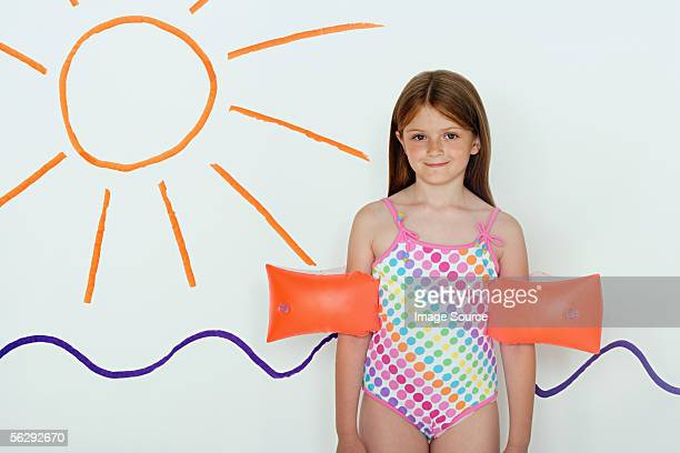 Girl by picture of sun and sea