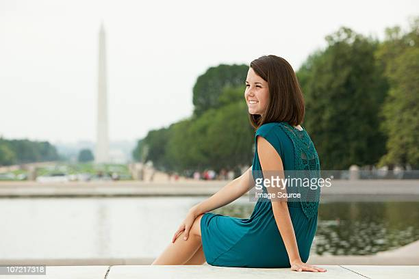 Girl by reflecting pool with washington monument in distance