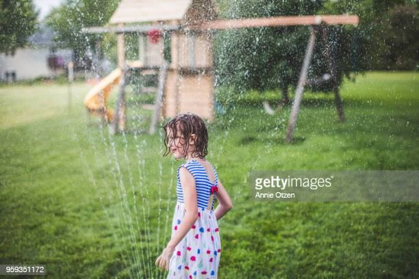 girl by sprinkler - annie sprinkle stock pictures, royalty-free photos & images