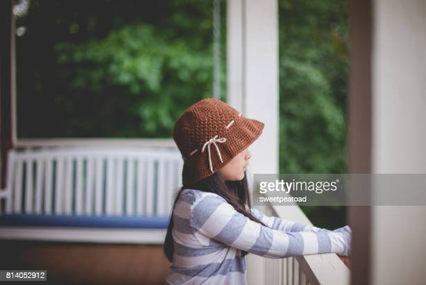 Girl by the porch