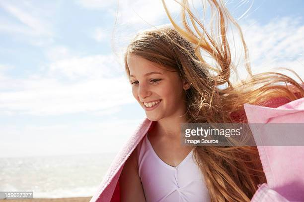 girl by the sea wearing a towel, wind in her hair - saltdean stock pictures, royalty-free photos & images