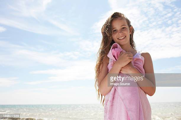 girl by the sea, wrapped in towel - saltdean stock pictures, royalty-free photos & images
