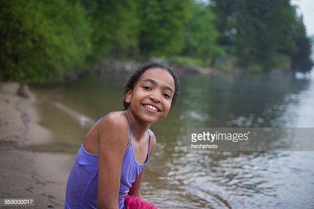 Girl by water on summer vacation at Lake George, New York, USA