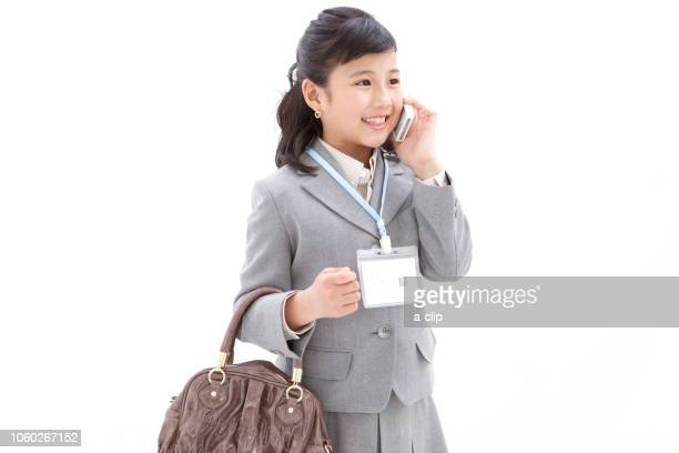 girl calling on a smartphone - adult imitation stock pictures, royalty-free photos & images