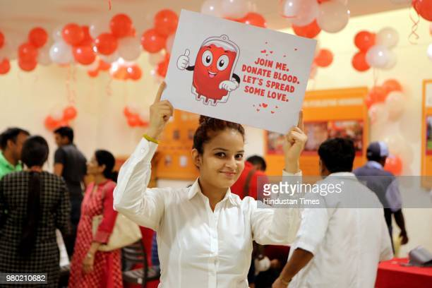A girl campaigns during a blood donation camp organised by Aarone Group along with Select Citywalk one of the most popular shopping malls in Delhi in...