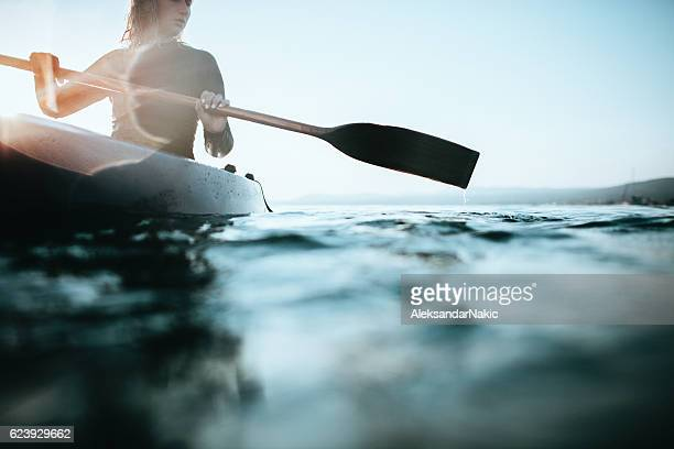 girl canoeist - kajak stock-fotos und bilder