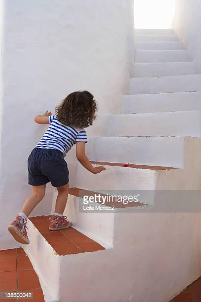 Girl carefully climbing steps