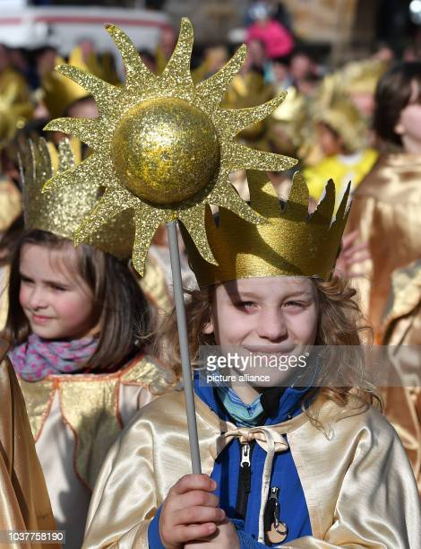A girl carries a small sun during the traditional spring festival parade in Eisenach Germany 25 March 2017 This year's theme is '500 years of...