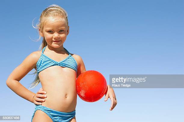 girl carrying ball - ombelico foto e immagini stock