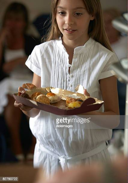 girl carrying cakes