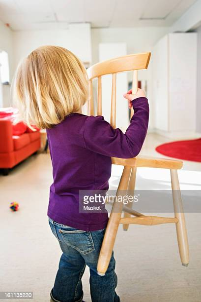 girl carrying chair - carrying stock pictures, royalty-free photos & images