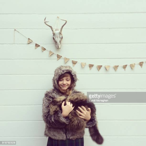 Girl Carrying Maine Coon Cat