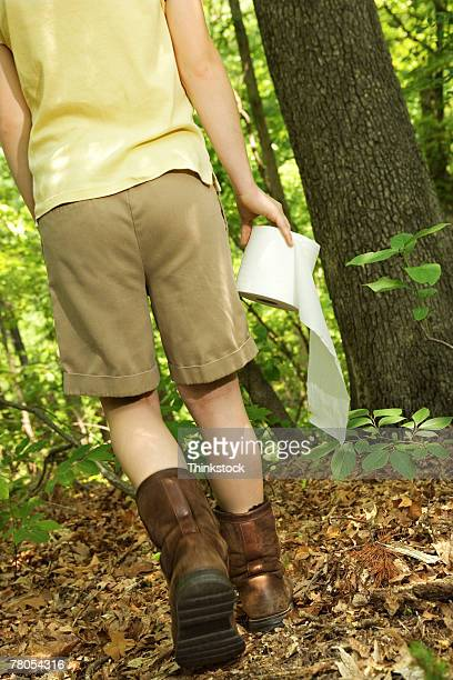 girl carrying toilet paper in woods - toilet paper tree stock pictures, royalty-free photos & images