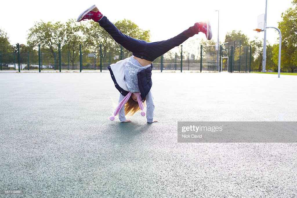 girl cartwheeling : Stock Photo