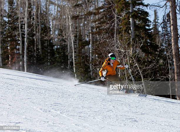 girl carving a turn on skis - park city stock pictures, royalty-free photos & images